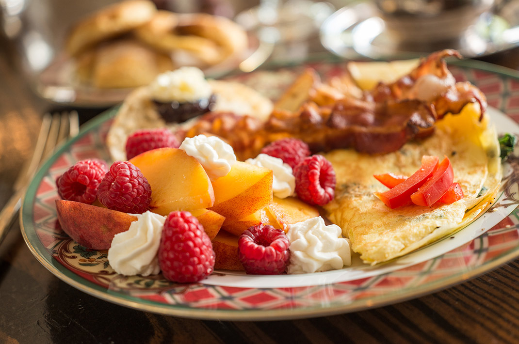 Fruit, eggs and bacon on a plate