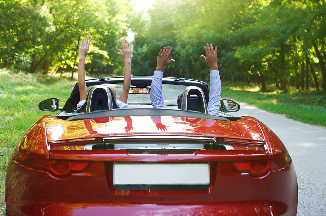 Couple driving in convertible on honeymoon in WV