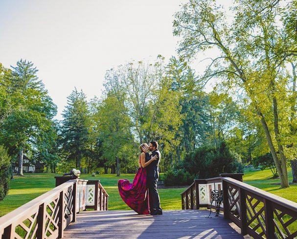 Elope in West Virginia kissing on the bridge