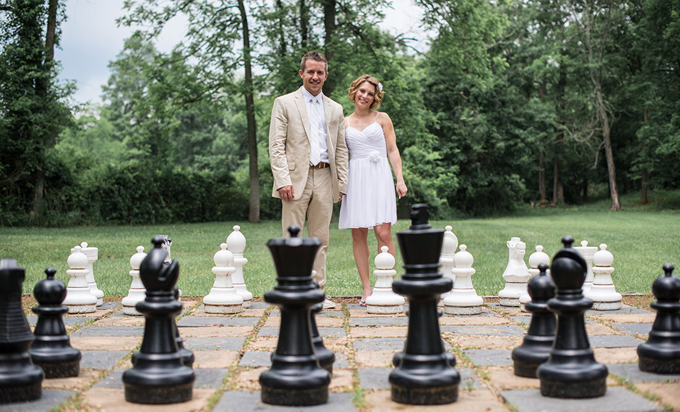 Couple playing life size chess