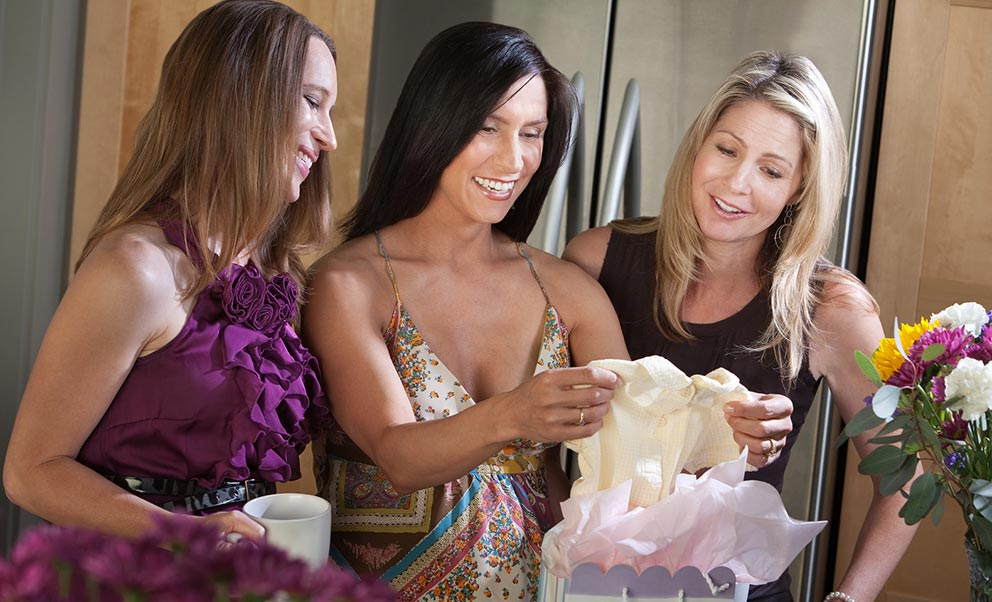 Woman opening gifts during bridal shower