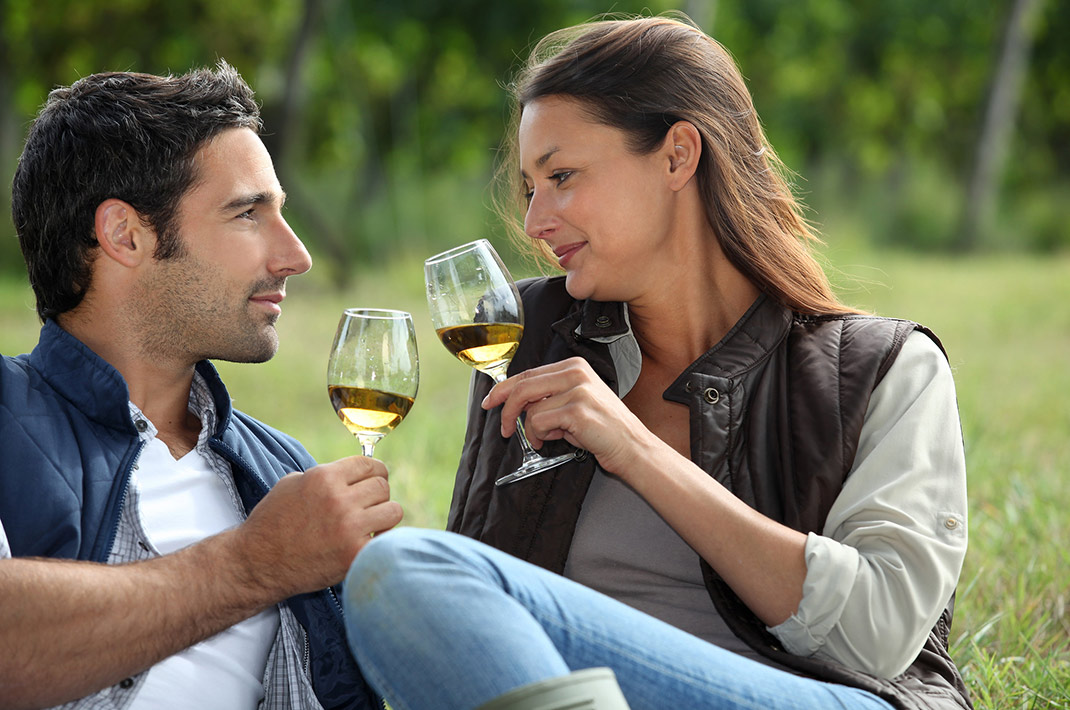 Couple enjoying wine in the grass