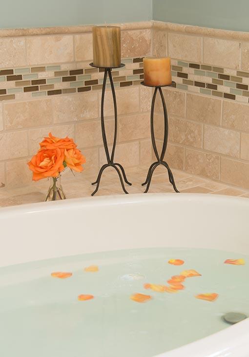 Orange rose petals in the bath tub