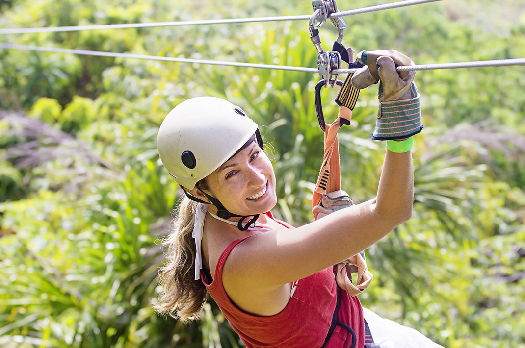 Woman smiling while zip lining