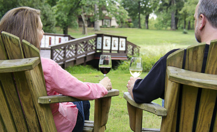 Man and Woman drinking wine in our gardens
