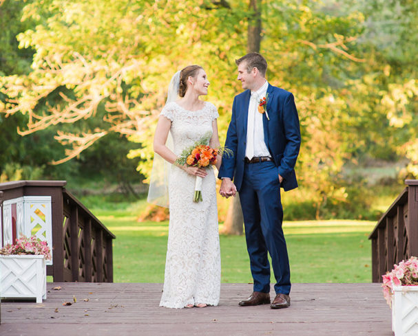 Bride and groom holding hands on a bridge at a West Virginia Wedding Venue