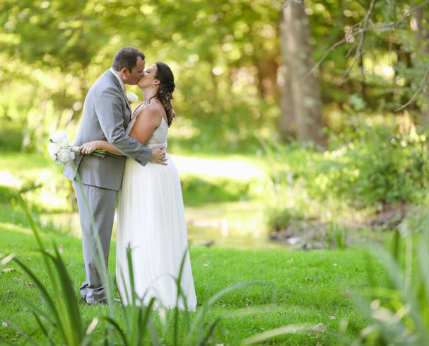 Newlyweds kissing at our West Virginia Wedding Venue