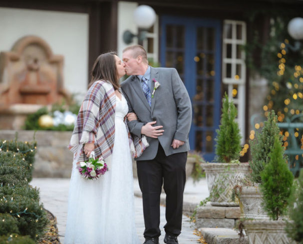 Couple kisses at our winter wedding in West Virginia