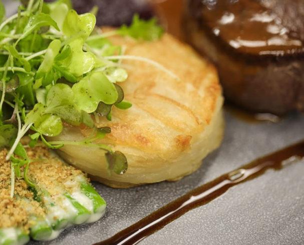 Prime filet mignon, Lyonnaise potatoes, asparagus gratin, red onion jam, jus at Hillbrook Restaurant