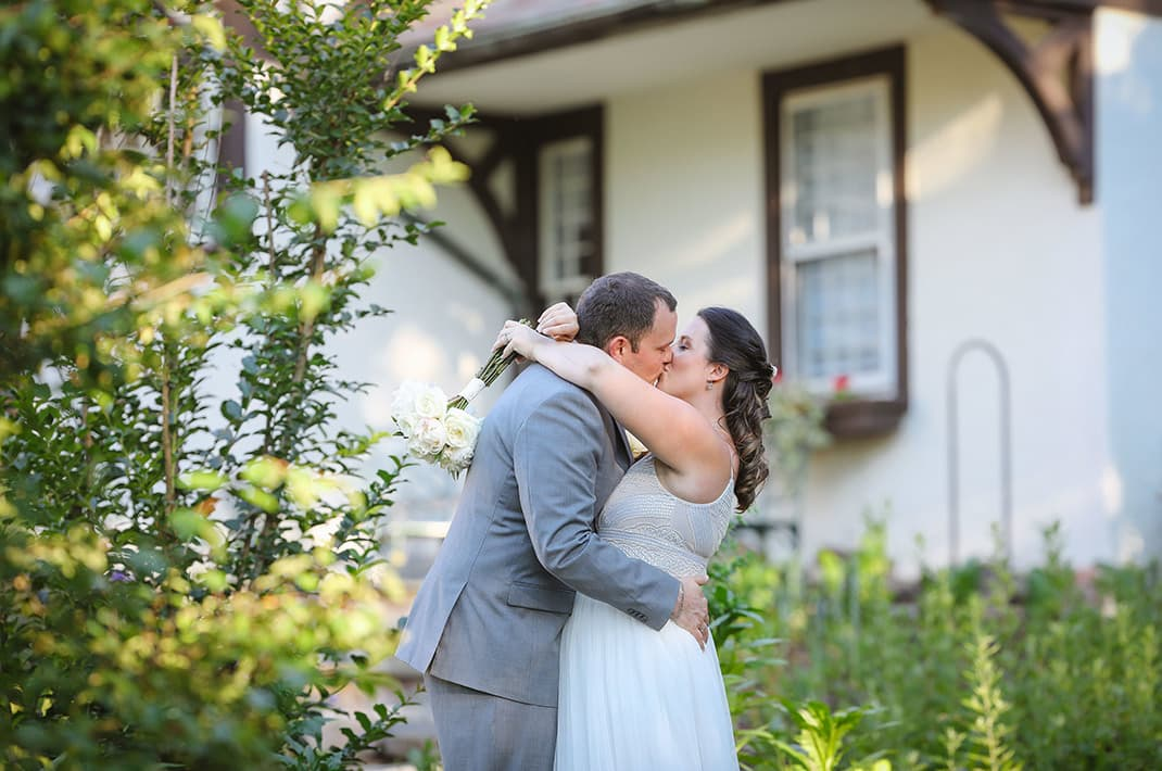 Romantic couple kissing at their MicroWedding at Hillbrook Inn